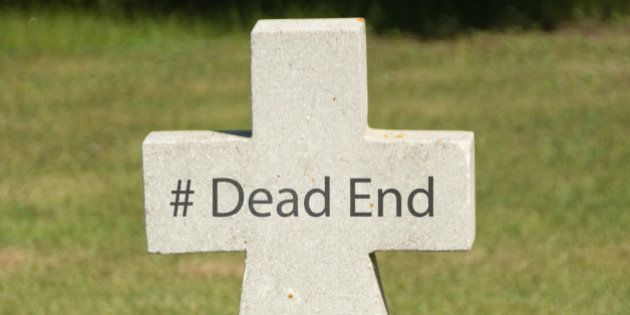 Hashtag Dead End written on an older marble tombstone with copy