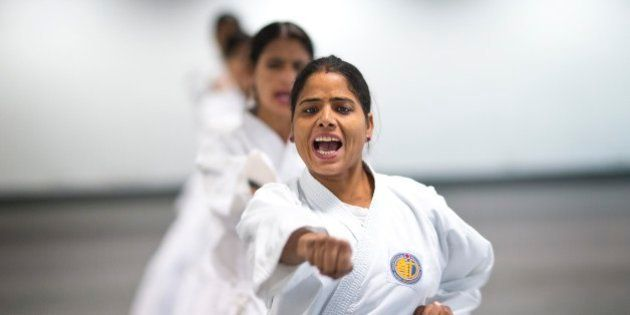 Women from the Delhi police force, undergo martial arts training at an institute in New Delhi, India,...