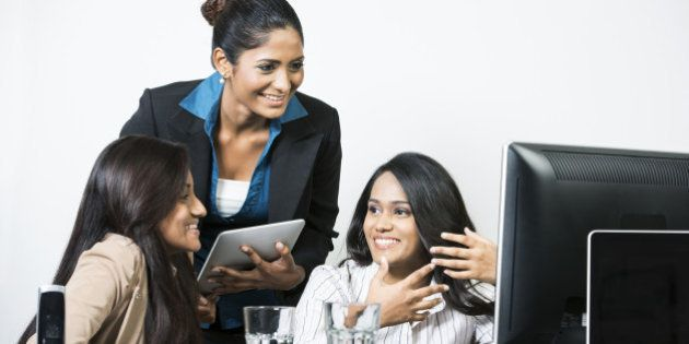 Group of happy Indian business women in a meeting at the