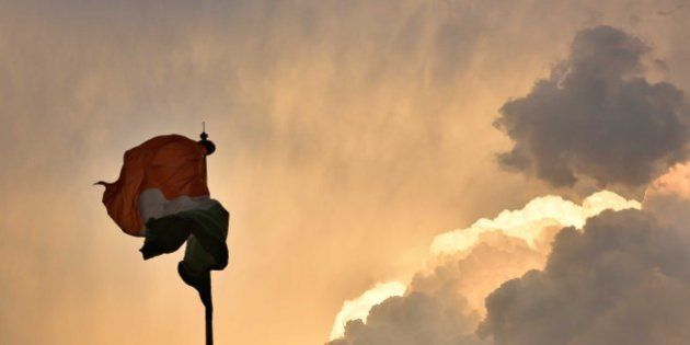 NEW DELHI, INDIA - MARCH 12: The Indian flag makes various forms due to fast winds as dark clouds engulfed...