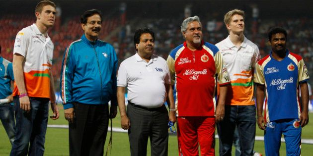 Pune Warriors team owner Subroto Roy, second left, and Royal Challengers Bangalore team owner Vijay Mallya,...