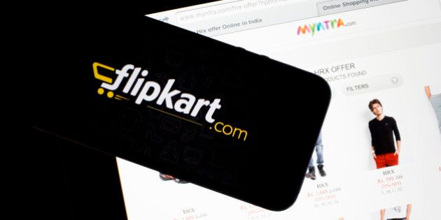 Flipkart's application loading page, left, and the Myntra.com website are displayed on an Apple Inc....