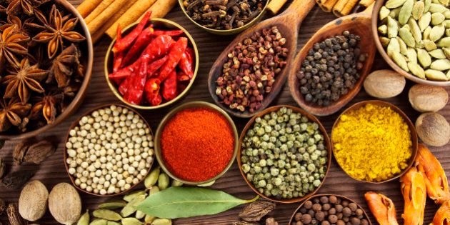 Spices and herbs in metal bowls and wooden spoons. Food and cuisine