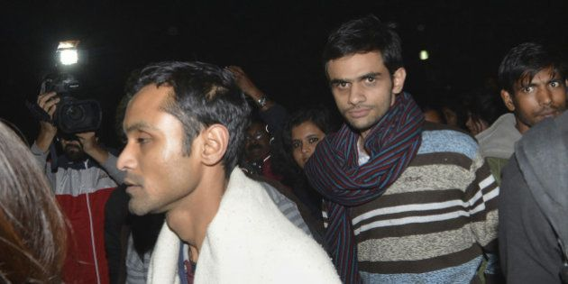 This photograph taken late on February 23, 2016 shows Indian student activist Umar Khalid (C) and Anirban...