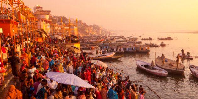 Hindus praying and bathing at the river Ganges, Varanasi at