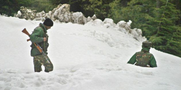 Indian Army soldiers patrol near the Jammu-Srinagar highway in Patnitop, about 110 kilometers (69 miles)...