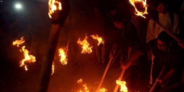 Indian Leftist student activists carry torches and shout slogans against the Bharatiya Janata Party (BJP)-led...
