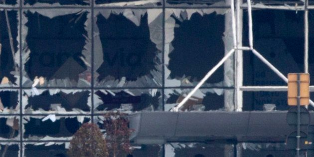 The blown out windows of Zaventem airport are seen after a deadly attack in Brussels, Belgium, Tuesday,...