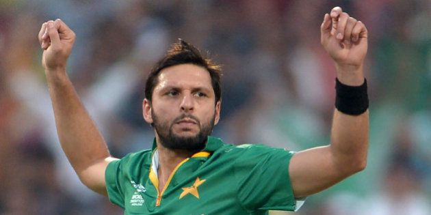 Pakistan's captain Shahid Afridi celebrates after the dismissal of Bangladesh's batsman Sabbir Rahman...