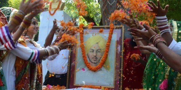 ALLAHABAD, INDIA - 2014/09/27: Students offer flowers for the freedom fighter Bhagat Singh on the occasion...