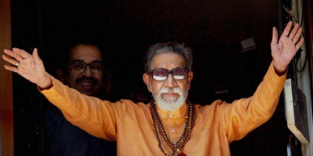 FILE- In this Jan 23, 2011 file photo, Hindu hardline Shiv Sena party leader Bal Thackeray waves at party...