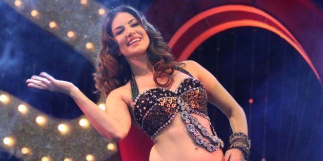 Adult film star Sunny Leone performs during a promotional event for the upcoming movie 'Shootout At Wadala'...