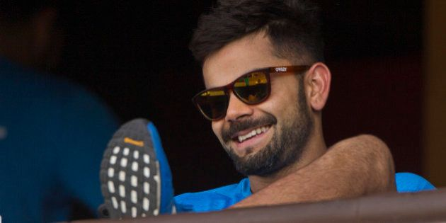 India's Virat Kohli smiles as he rests after a practice session ahead of their match against New Zealand...