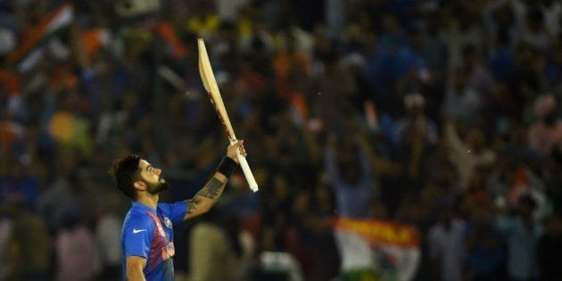 India's Virat Kohli celebrates after victory in the World T20 cricket tournament match between India...