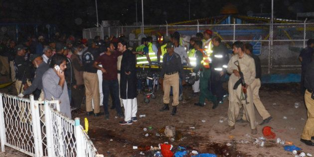 LAHORE, PUNJAB, PAKISTAN - 2016/03/27: (EDITORS NOTE: Image contains graphic content.) Pakistani rescuers...