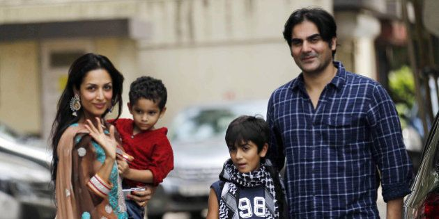 Indian Bollywood film actor Malaika Arora Khan (L), with husband Arbaz khan and sons, greets well-wishers...