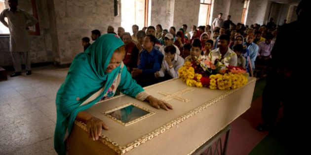 The grandmother of Pakistani Christian boy Sahil Pervez, mourns his death, at a church in Lahore, Pakistan,...