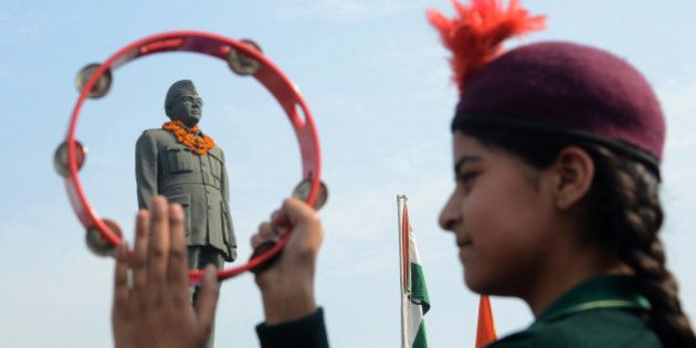 An Indian school band performs near the statue of freedom fighter, Netaji Subhash Chandra Bose in Amritsar...