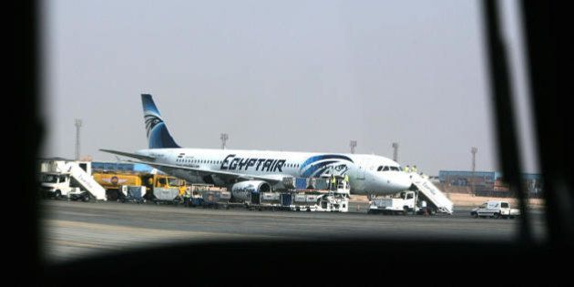 A picture taken in Cairo on August 19 2008 shows an Egypt Air plane supporting a new logo parked on the...