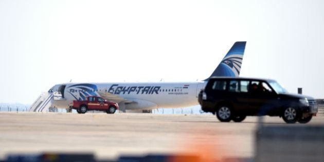 An EgyptAir Airbus A-320 sits on the tarmac of Larnaca airport after it was hijacked and diverted to...