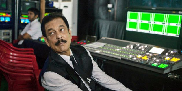 Subrata Roy, chairman of Sahara Group, observes from a media room during the company's attempt to break...