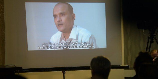 Members of the media watch a projection of a video showing arrested man Kulbhushan Yadav, who is suspected...