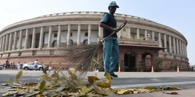 NEW DELHI, INDIA - MARCH 8: A Sweeper cleans at Parliament House on the occasion of International Women's...