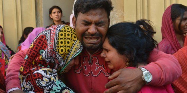 Pakistani Christians mourn the death of a blast victim of the March 27 suicide bombing, in Lahore on...