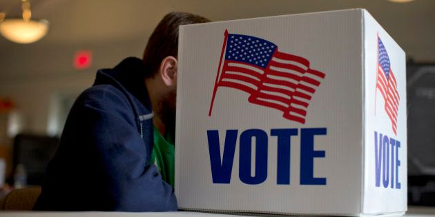 A voter fills our a provisional ballot by hand for the midterm elections at a polling place in Annapolis,...