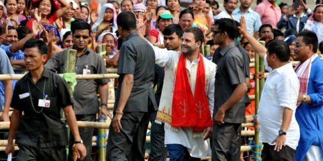 Rahul Gandhi, vice-president of the Indian National Congress party, waves to the crowd at an election...