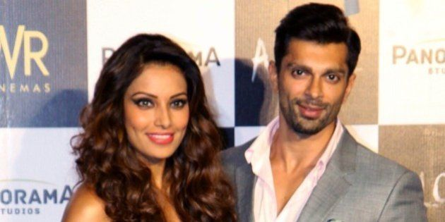 Indian Bollywood actors Bipasha Basu (L) and Karan Singh Grover pose for a photograph during a promotional...