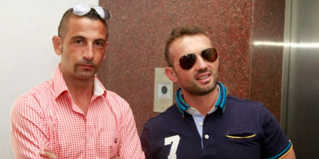 Italian sailors Massimiliano Latorre (L) and Salvatore Girone wait to board an elevator to reach the...