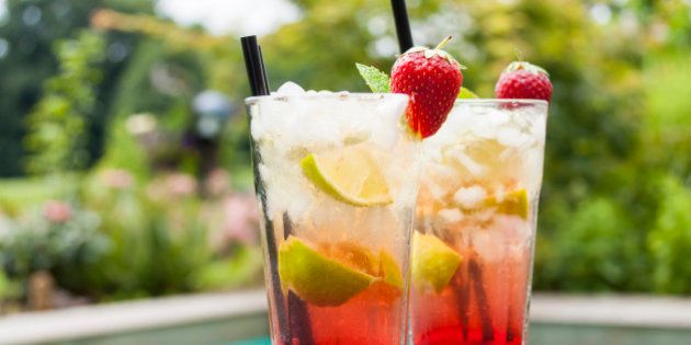 Strawberry Caipirinha with fresh mint and strawberry in