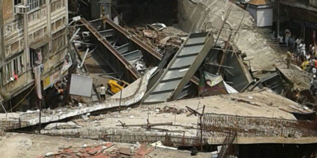 KOLKATA, INDIA - MARCH 31: (EDITORS NOTE: Image was created with a smartphone) A part of flyover collapsed...