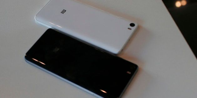 The new Xiaomi Mi5 are displayed during the Mobile World Congress wireless show in Barcelona, Spain,...
