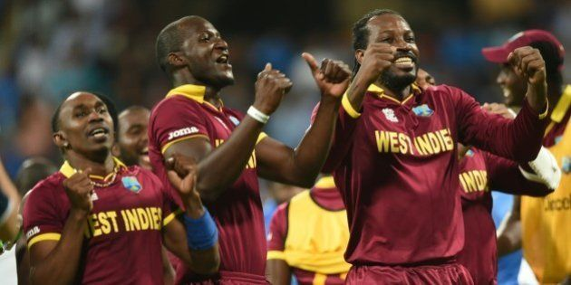 West Indies's captain Darren Sammy(C) Dwayne Bravo(L)and Chris Gayle(R)celebrate after victory in the...