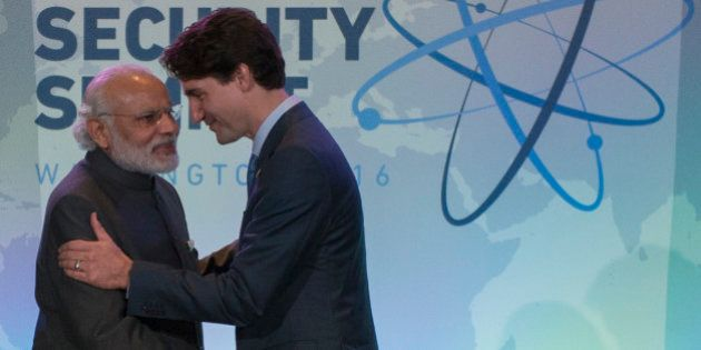Indian Prime Minister Narendra Modi (L) shakes hands with Canadian Prime Minister Justin Trudeau at a...