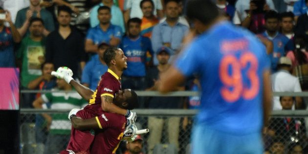 West Indies Lendl Simmons(L)celebrates after winning the World T20 cricket tournament semi-final match...