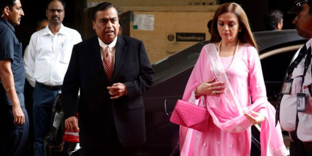 Mukesh Ambani, chairman and managing director of the Reliance Industries Ltd., and his wife Nita arrive...