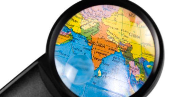 India on globe viewed through a magnifying