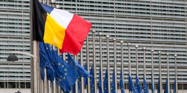 The Belgian and French flags fly at half mast along with EU flags during a minute of silence outside...