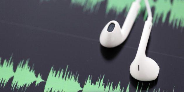 white headphones on top of computer