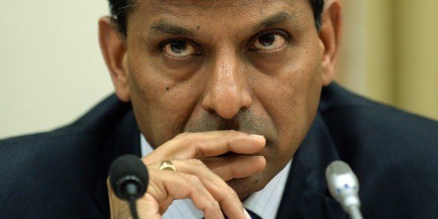 Reserve Bank of India (RBI) governor Raghuram Rajan listens to a question during a news conference at...