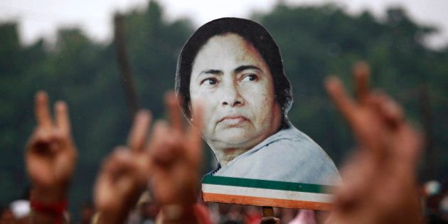 Supporters hold a cut-out of the newly appointed chief minister of eastern Indian state of West Bengal...