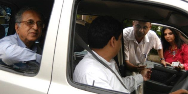 INDIA - JUNE 22: Car Pooling, Rishi Agarwal display his I card to get into the Car Pooling concept floated...