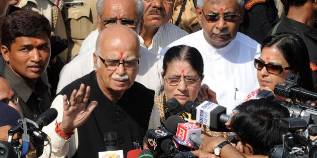 Prime ministerial candidate for the Bharatiya Janata Party (BJP), L.K.Advani (L), accompanied by his...