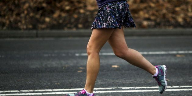 A woman jogs in her shorts during a warm day in Central Park, New York December 25, 2015. Much of the...