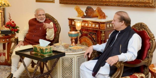Pakistani Prime Minister Nawaz Sharif (R) talks with his Indian counterpart Narendra Modi in Lahore,...