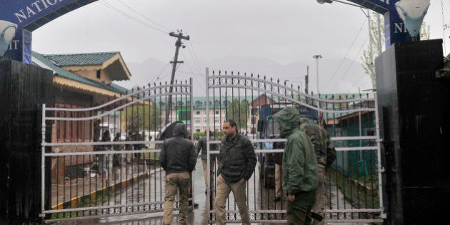 SRINAGAR, INDIA - APRIL 6: Police men deployed outside the gate of Srinagar NIT on April 6, 2016 in Srinagar,...