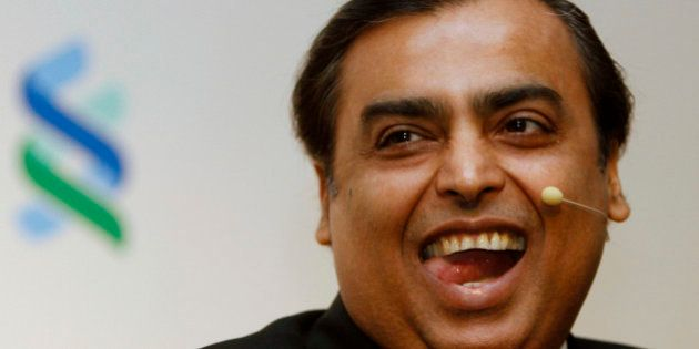 Mukesh Ambani, Chairman and Managing Director of Reliance Industries, reacts during the 2011 spring membership...